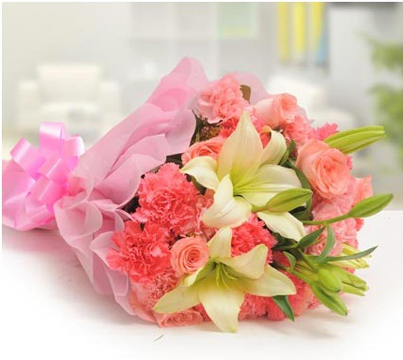 10 Pink Carnations, 8 Pink Roses and 2 White Lilies with Pink Paper Packing by FNP