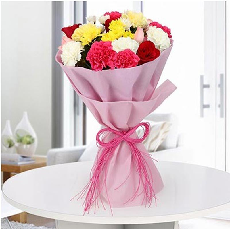 10 Carnations and 5 Roses with Pink Paper Packing by FNP