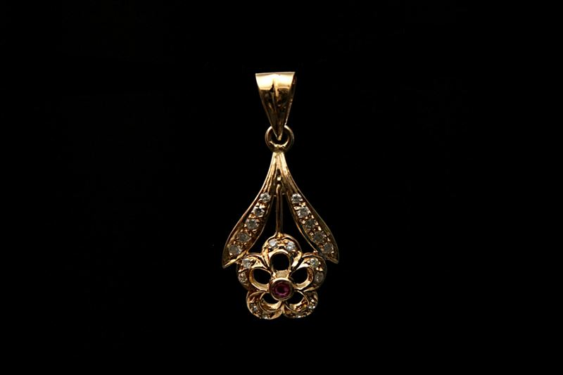 Ruby and Diamond Pendant engraved in 18-Carat Gold