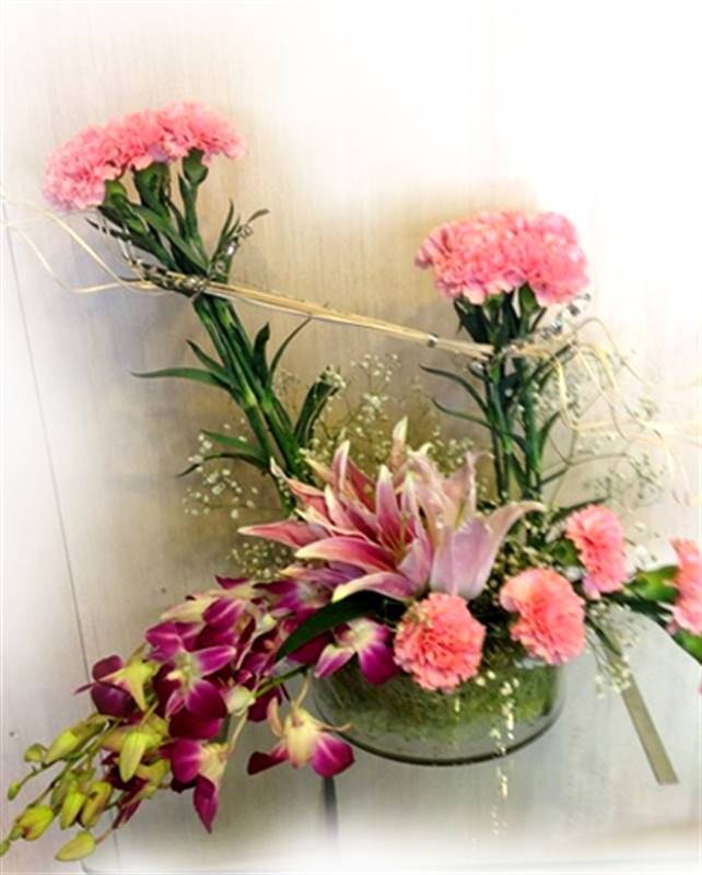 2 Lillies, 5 Orchids and 15 Carnations in a Basket by FNP Flowers