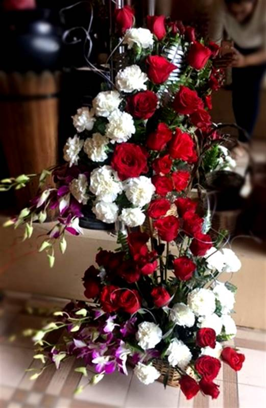 Mix Flower of Roses, Carnations and Orchids in a Basket by FNP