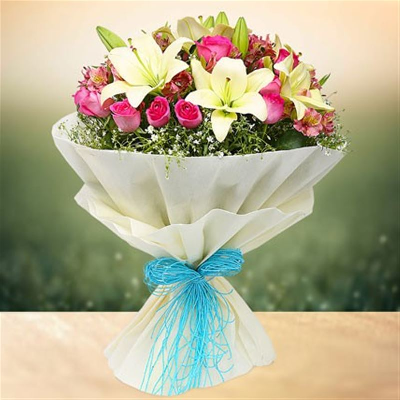 20 Pink Roses and 5 Lilies with White Paper Packing by FNP