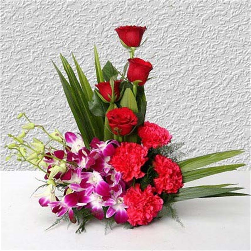 4 Roses, 4 Carnations and 6 Orchids by FNP