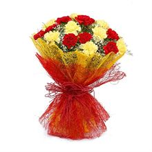 15 Red and Yellow Carnations with Jute Packing by FNP