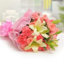 10 Pink Carnations, 5 Pink Roses and 2 Lilies with Pink Paper Packing by FNP